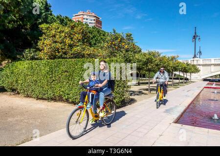 Turia Valencia gardens, family bike rides in park, Spain bicycle city Europe - Stock Photo