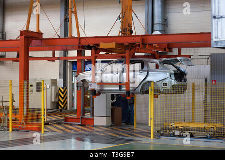 Russia, Izhevsk - December 15, 2018: LADA Automobile Plant Izhevsk. The body of new car on the hydraulic lift conveyor line. - Stock Photo