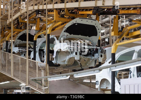 Russia, Izhevsk - December 15, 2018: LADA Automobile Plant Izhevsk. The bodies of new cars after painting on the conveyor line. - Stock Photo