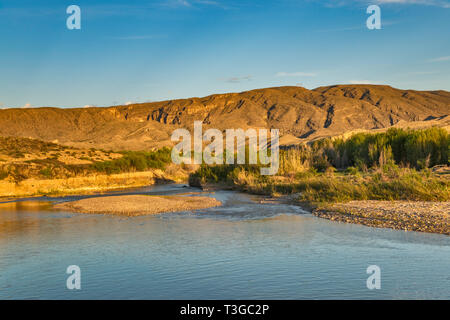 Rio Grande, mountains in Mexico in distance, view from Talley campsite, at sunrise, Mariscal Canyon area,  Big Bend National Park, Texas, USA - Stock Photo