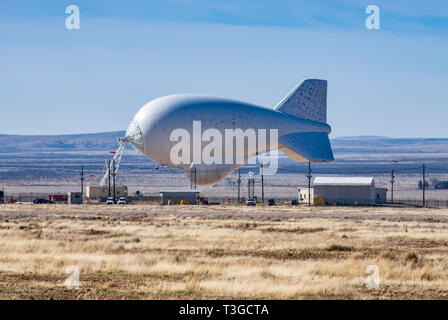 Lockheed Martin 420K aerostat, TARS, or Tethered Aerostat Radar System, helium-filled balloon with downward-looking radar for drug smugglers aircraft  - Stock Photo