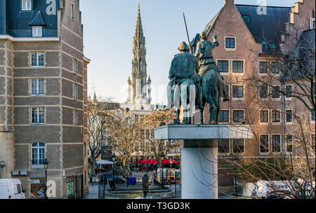 Sculpture of Don Quixote and Sancho Panza on the Spain Square (Place d'Espagne) facing Bela Bartok statue and tower of The Brussels Town Hall. - Stock Photo
