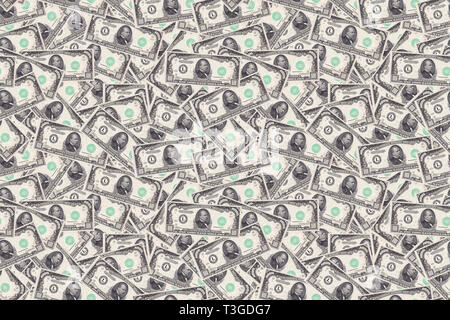 Motley background from chaotically scattered thousand dollar banknotes abstract seamless geometrical patterns background. - Stock Photo