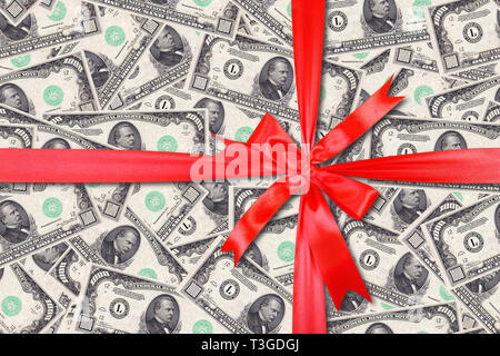 Motley background from chaotically scattered dollar banknotes gift tied red bow abstract seamless geometrical patterns background. - Stock Photo