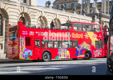 The City Sightseeing open-top tour bus in High Street, Oxford - Stock Photo