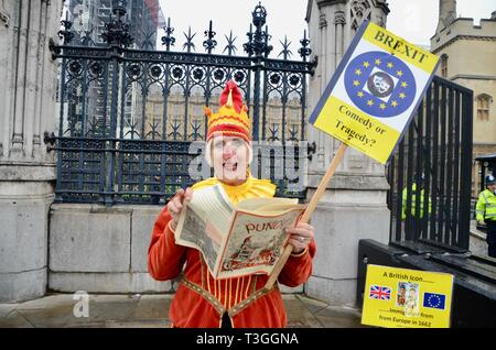a lone woman protester in punch and judy costume outside parliament london uk anti brexit demo - Stock Photo