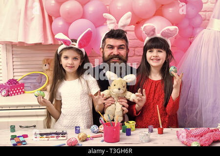 Family On Easter painting eggs - Stock Photo