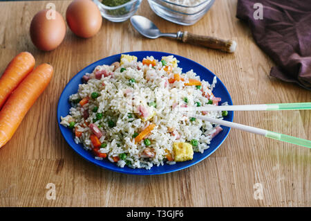 rice 3 delights in bamboo fiber dish with resin sticks - Stock Photo