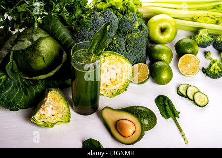 Green smoothie avocado and cauliflower drinks on white wooden background. Raw food and drink. - Stock Photo