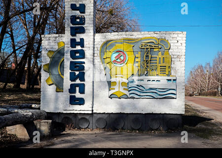 City sign of Chernobyl Town, Ukraine, April 2019. The town, after which the nuclear power plant was named, is still inhabitated by workers associated  - Stock Photo