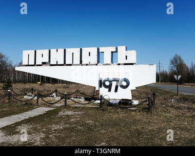 The town sign of the city of Pripyat in the exclusion zone of Chernobyl, Ukraine, April 2019 - Stock Photo