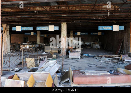 Abandoned supermarket in the ghost town of Pripyat inside the exclusion zone of Chernobyl, Ukraine, April 2019 - Stock Photo