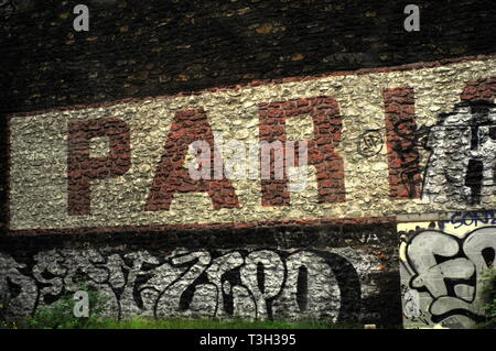 AJAXNETPHOTO. PARIS, FRANCE. - PARIS DEFACED - APPROACHING GARE ST.LAZARE TRAIN STATION; NAME ON WALL LEADING TO TERMINUS FRAMED BY GRAFFITI. PHOTO:JONATHAN EASTLAND/AJAX REF:D121506_2799 - Stock Photo
