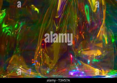 multicolored  holographic iridescent surface wrinkled foil  pastel - Stock Photo