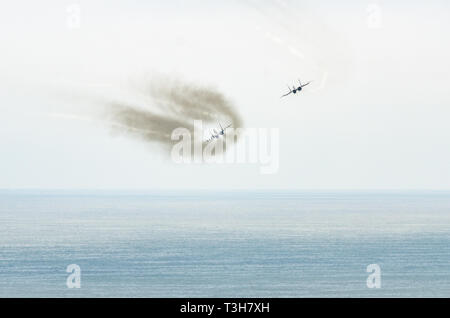 Military plane plowing the skies of Lima - Peru. - Stock Photo