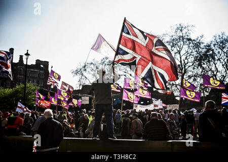 Political rally uk / politics uk / political protest - protester holding a flag on a peaceful march pro Brexit rally on 29 March, Brexit day 2019 - Stock Photo