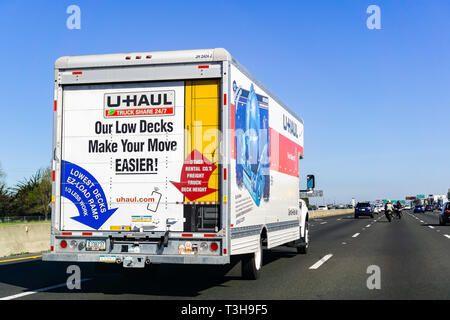 March 31, 2019 Oakland / CA / USA - U-Haul van travelling on the freeway in San Francisco bay area; U-Haul is an American company offering DIY moving  - Stock Photo