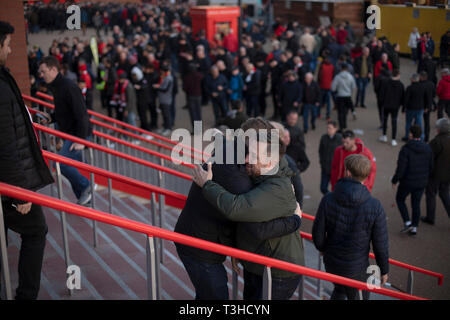 Supporters gathering at Anfield Stadium prior to Liverpool's Champions League quarter-final first leg tie against Porto. The English team beat their opponents from Portugal 2-0. - Stock Photo