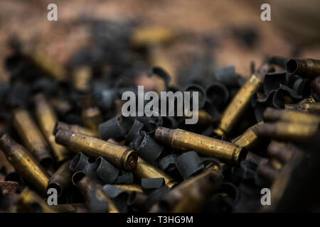 CAMP TITIN, Jordan (April 4, 2019) Spent brass casings of 7.62mm rounds, fired by Marines with 5th Platoon, Charlie Company, Fleet Anti-Terrorism Security Team, Central Command (FASTCENT), lie on the ground. FASTCENT provides expeditionary antiterrorism and security forces to embassies, consulates and other vital national assets throughout the region. (U.S. Marine Corps photo by Sgt. Aaron S. Patterson/Released) - Stock Photo