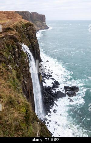 Mealt Falls with Kilt Rock sea-cliffs in background on east coast of Isle of Skye, Highland Region, Scotland, UK - Stock Photo