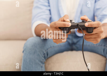 Young man playing video games at home - Stock Photo