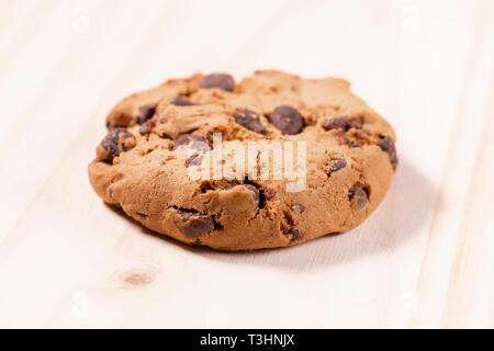 Oatmeal cookies with chocolate on a wooden background. Free space for lettering and design - Stock Photo