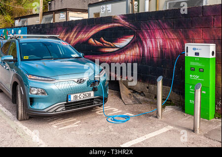 Hyundai electric car being charged at an ESB electric charging point in Bantry, West Cork, Ireland. - Stock Photo