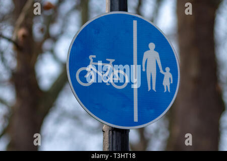 Road sign used in UK - Separate lanes for pedestrians and cyclists - Stock Photo