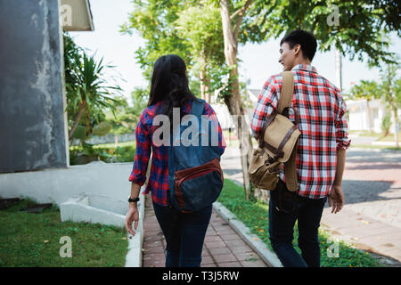 college student walking to campus - Stock Photo