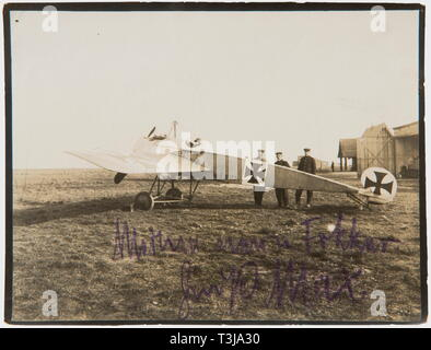 First Lieutenant Max Immelmann (1890 - 1916), a signed photo of his Fokker E IV 127/15 The Fokker with its double MG on a field in front of a hangar with Immelmann in the cockpit (8.8 x 11.4 cm). On the lower edge in purple indelible pencil 'My new Fokker - greetings, Max'. On the back in pencil 'Immelmann in his (2nd) Fokker, 160 h.p., in which he had his fatal accident on 18th June.' The Fokker E IV was developed in 1915, but only came into use at the front in April 1916, the delay was due to a faulty MG synchronising gear. Immelmann however di, Additional-Rights-Clearance-Info-Not-Available - Stock Photo