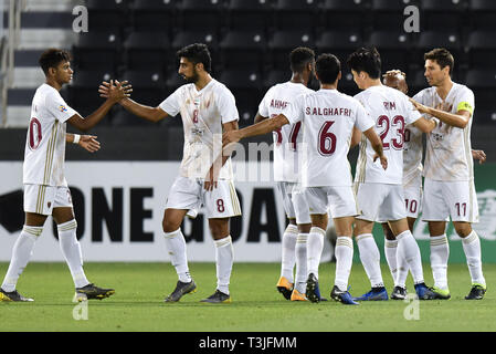 Doha, Qatar. 9th Apr, 2019. Sebastian Tagliabue (1st R) of Al Wahda FSCC celebrates with teammates after scoring during the AFC Asian Champions League group B match between Qatar's Al Rayyan SC and UAE's Al Wahda FSCC at Jassim Bin Hamad Stadium in Doha, capital of Qatar, April 9, 2019. Al Wahda won 2-1. Credit: Nikku/Xinhua/Alamy Live News - Stock Photo