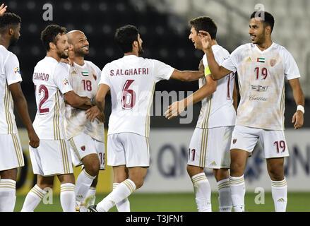 Doha, Qatar. 9th Apr, 2019. Sebastian Tagliabue (2nd R) of Al Wahda FSCC celebrates during the AFC Asian Champions League group B match between Qatar's Al Rayyan SC and UAE's Al Wahda FSCC at Jassim Bin Hamad Stadium in Doha, capital of Qatar, April 9, 2019. Al Wahda won 2-1. Credit: Nikku/Xinhua/Alamy Live News - Stock Photo