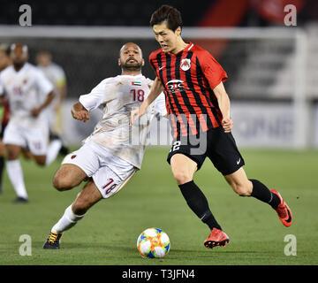 Doha, Qatar. 9th Apr, 2019. Ahmed Ali (L) of Al Wahda FSCC vies with Koh Myong-Jin of Al Rayyan SC during the AFC Asian Champions League group B match between Qatar's Al Rayyan SC and UAE's Al Wahda FSCC at Jassim Bin Hamad Stadium in Doha, capital of Qatar, April 9, 2019. Al Wahda won 2-1. Credit: Nikku/Xinhua/Alamy Live News - Stock Photo