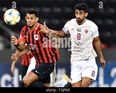 Doha, Qatar. 9th Apr, 2019. Hamdan Al Kamali (R) of Al Wahda FSCC vies with Gelmin Rivas of Al Rayyan SC during the AFC Asian Champions League group B match between Qatar's Al Rayyan SC and UAE's Al Wahda FSCC at Jassim Bin Hamad Stadium in Doha, capital of Qatar, April 9, 2019. Al Wahda won 2-1. Credit: Nikku/Xinhua/Alamy Live News - Stock Photo