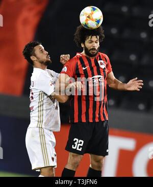Doha, Qatar. 9th Apr, 2019. Leonardo (L) of Al Wahda FSCC vies with Ahmed El Sayed of Al Rayyan SC during the AFC Asian Champions League group B match between Qatar's Al Rayyan SC and UAE's Al Wahda FSCC at Jassim Bin Hamad Stadium in Doha, capital of Qatar, April 9, 2019. Al Wahda won 2-1. Credit: Nikku/Xinhua/Alamy Live News - Stock Photo