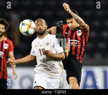 Doha, Qatar. 9th Apr, 2019. Ahmed Ali (L) of Al Wahda FSCC vies with Lucca of Al Rayyan SC during the AFC Asian Champions League group B match between Qatar's Al Rayyan SC and UAE's Al Wahda FSCC at Jassim Bin Hamad Stadium in Doha, capital of Qatar, April 9, 2019. Al Wahda won 2-1. Credit: Nikku/Xinhua/Alamy Live News - Stock Photo