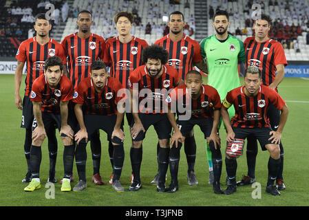 Doha, Qatar. 9th Apr, 2019. Players of Al Rayyan SC line up before the AFC Asian Champions League group B match between Qatar's Al Rayyan SC and UAE's Al Wahda FSCC at Jassim Bin Hamad Stadium in Doha, capital of Qatar, April 9, 2019. Al Wahda won 2-1. Credit: Nikku/Xinhua/Alamy Live News - Stock Photo