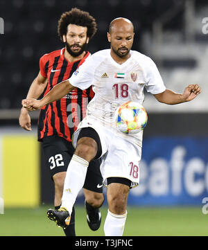 Doha, Qatar. 9th Apr, 2019. Ahmed Ali (R) of Al Wahda FSCC vies with Ahmed El Sayed of Al Rayyan SC during the AFC Asian Champions League group B match between Qatar's Al Rayyan SC and UAE's Al Wahda FSCC at Jassim Bin Hamad Stadium in Doha, capital of Qatar, April 9, 2019. Al Wahda won 2-1. Credit: Nikku/Xinhua/Alamy Live News - Stock Photo