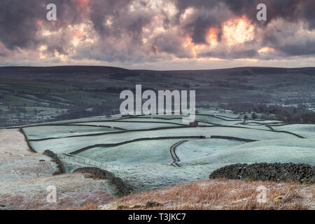 Teesdale, County Durham UK. Wednesday 10th April. UK Weather. It was a cold and frosty start to the day in Teesdale and as the sun began to rise spectacular crepuscular rays began to rake across the landscape. Credit: David Forster/Alamy Live News - Stock Photo