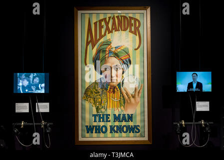 London, UK. 10th Apr, 2019. Promotional poster for 'Alexander, the man who knows'. Preview of 'Smoke and Mirror: the psychology of magic', a major new exhibition at Wellcome Collection and the first ever to focus on the relationship between magic and psychology. The exhibition run 11 April to 15 September 2019. Credit: Stephen Chung/Alamy Live News - Stock Photo