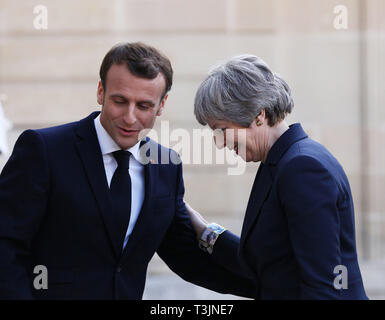 Paris, France. 9th Apr, 2019. French President Emmanuel Macron (L) welcomes visiting British Prime Minister Theresa May at the Elysee Palace in Paris, France, April 9, 2019. May held talks in Berlin with German Chancellor Angela Merkel and in Paris with French President Emmanuel Macron during a day of whistle-stop diplomacy in her race to win a delay to the country's departure from the European Union (EU). Credit: Gao Jing/Xinhua/Alamy Live News - Stock Photo