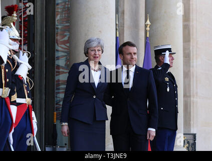 Paris, France. 9th Apr, 2019. French President Emmanuel Macron (R, front) welcomes visiting British Prime Minister Theresa May at the Elysee Palace in Paris, France, April 9, 2019. May held talks in Berlin with German Chancellor Angela Merkel and in Paris with French President Emmanuel Macron during a day of whistle-stop diplomacy in her race to win a delay to the country's departure from the European Union (EU). Credit: Gao Jing/Xinhua/Alamy Live News - Stock Photo