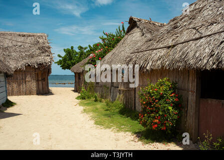 Street view of traditional housing (rural thatch houses / cabanas) in Kuna or Guna Yala indigenous village. San Blas Islands, Panama. Oct 2018 - Stock Photo