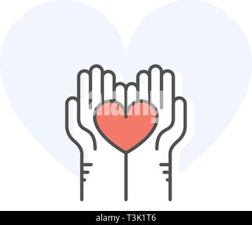 Helping hands holding heart - charity, donation and volunteer help concept - Stock Photo