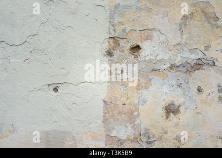 Old Wall With Peel Grey Stucco Texture. Retro Vintage Worn Wall Background. Decayed Cracked Rough Abstract Banner Surface. - Stock Photo