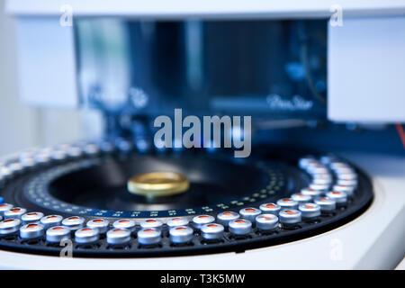 Glass tube into the machine of the laboratory - Stock Photo