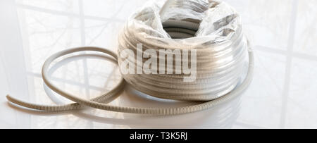 Corrugated gray plastic pipes used for electrical lines - Stock Photo