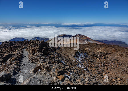 Pico viejo crater and hiking path surrounded by lava fields - Stock Photo
