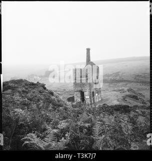 Wheal Betsy pumping engine house, Mary Tavy, Devon, 1967. Wheal Betsy engine house viewed from the south-west, with signs warning of falling masonry attached to the structure. - Stock Photo