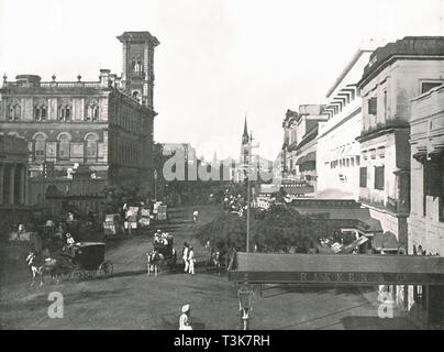 """Court House Street, Calcutta, India, 1895. View of the 'Dead Letter Office', the Telegraph Office in Calcutta, (now Kolkata), Bengal, India. The building, the central sorting office for incoming mail to the city, is Italianate in style with a 120-foot campanile tower. On the right are the premises of Ranken & Co, military outfitters. From """"Round the World in Pictures and Photographs: From London Bridge to Charing Cross via Yokohama and Chicago"""". [George Newnes Ltd, London, 1895] - Stock Photo"""